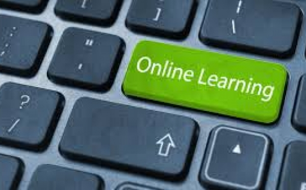 An image of a keyboard with a green online learning button. This style of self-education has huge benefits/